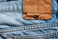 Blank leather jeans label sewed. On a blue jeans Royalty Free Stock Photography