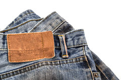 Blank leather jeans label sewed. Stock Image