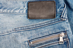 Blank leather jeans label sewed on a blue jeans Royalty Free Stock Photo