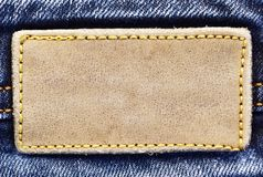 Blank leather jeans label sewed on a blue jeans royalty free stock photography