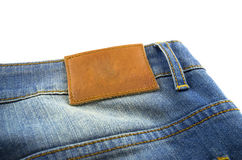 Blank leather jeans label sewed on a blue jeans Royalty Free Stock Photos