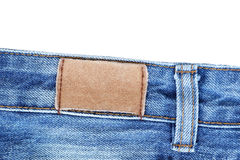 Blank leather jeans label sewed on jeans. Royalty Free Stock Image