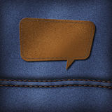 Blank leather label on a blue jeans Royalty Free Stock Photos