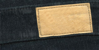 Blank leather label on jeans Stock Photos