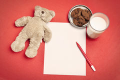 Blank letter with bear, cookies and milk Stock Photography