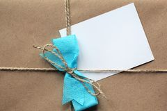 Blank letter on a brown paper package. Blank letter for your text on a brown paper package tied with string as a gift stock photos