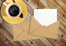 Blank letter with the envelope on coffee table Royalty Free Stock Photos