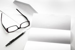 blank of letter paper and envelope with eyeglasses and pen Stock Photography