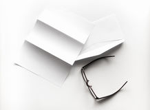 blank of letter paper and envelope with eyeglasses and pen Stock Photo