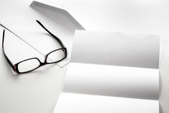 Blank of letter paper and envelope with eyeglasses Royalty Free Stock Photography