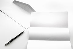 blank of letter paper and white envelope with pen Stock Photo