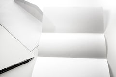 blank of letter paper and white envelope with pen Stock Image