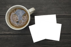 Blank letterhead and coffee cup on vintage wooden table background Royalty Free Stock Photos