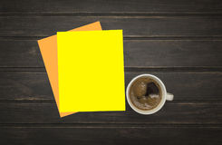 Blank letterhead and coffee cup on vintage wooden table background Royalty Free Stock Photo