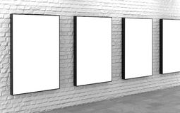 Blank lightboxes on white brick wall Royalty Free Stock Photography