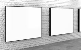Blank lightboxes on white brick wall Royalty Free Stock Images