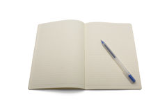 Blank lined notebook with blue pen. Isolated on white background Stock Photography