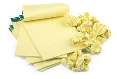 Blank lined notebooks. And crumpled paper on white background, natural shadow in front Stock Photo
