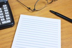 Blank Lined Pad on Wood Desk Royalty Free Stock Photos