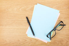 Blank lined paper with office supplies and glasses Stock Images