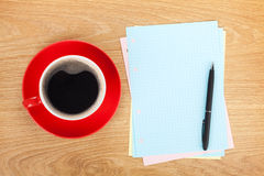 Blank lined papers with coffee cup and pen Stock Images