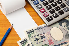 Blank list with Yen and calculator Royalty Free Stock Photography