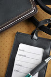 Blank luggage tag put on organizer book Stock Images