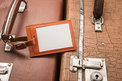 Blank luggage tag on suitcases Royalty Free Stock Photo