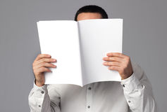 Blank magazine. Man reading a blank magazine Stock Photography
