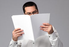 Blank magazine. Man reading a blank magazine Royalty Free Stock Photo