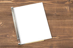 Blank magazine page on wooden background stock photography
