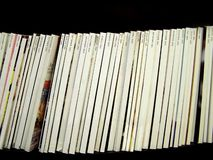 Blank Magazine Spines & Dates. A photograph of a long row of blank, white magazine spines Stock Image