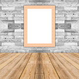 Blank maize wooden photo frame leaning at white brick wall. Blank maize wooden photo frame leaning at white brick wall,Template mock up for adding your design Royalty Free Stock Image