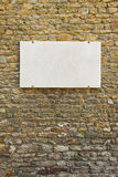 Blank marble plaque on italian stone wall Stock Image