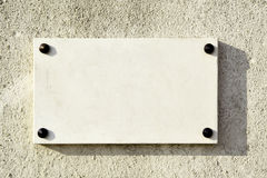 Blank marble signboard. Close-up over wall royalty free stock photography