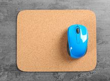 Blank mat and wireless mouse. On textured background Stock Photo