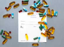Blank medical prescription and pills on gray background.  Royalty Free Stock Images