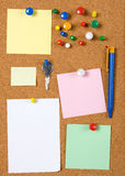 Blank memo notes on cork board. Blank memo notes pinned on cork notice board Royalty Free Stock Photos