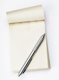 Blank memo pad with pen Stock Photos
