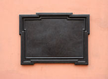 Blank memorial plaque. Blank cast-iron plaque on stone wall. Add your own text or image. Clipping path is included stock image