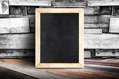 Blank menu blackboard leaning at plank wood wall and diagonal wo Stock Photography