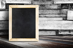Blank menu blackboard leaning at plank wood wall and diagonal wo Stock Image