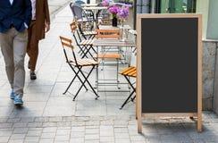 Blank menu blackboard on the street stock photos