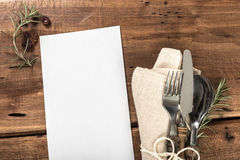 Blank Menu on Rustic Old Wooden Table With Cutlery Stock Image