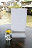 Blank menu stand with Shot Glass flowers. Blank menu stand on wood table with Shot Glass flowers Stock Photo