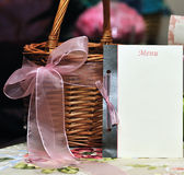 Blank menu to be filled. Blank menu card near a wedding basket, creating beautiful wedding table set Stock Photography