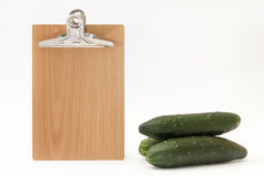 Blank message board with cucumbers Royalty Free Stock Photos