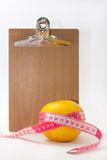Blank message board with grapefruit wrapped with tape measure Royalty Free Stock Photography