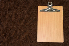 Blank message board on the soil Stock Photography
