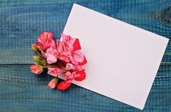 Blank message card and bouquet of flowers on blue wooden rustic table. Love, romantic, concept . Copy space background Royalty Free Stock Photography